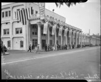 Craft workers on strike stand outside Metro-Goldwyn-Mayer Studios, Culver City, 1937