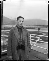 Tom Gwynee, sportswriter for Copley Press Newspapers, at Santa Anita Racetrack, Arcadia, 1930s