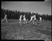 Female U.C.L.A. students playing soccer in a field, Los Angeles