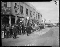"""Street shrine constructed for slain longshoreman Norman """"Big Bill"""" Gregg, San Pedro, 1937"""
