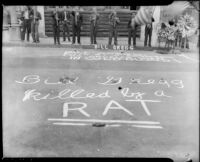 "Chalk writing in front of a street shrine for longshoreman Norman ""Big Bill"" Gregg, San Pedro, 1937"