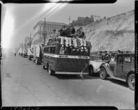 Trucks in the L.A.P.D. parade heading towards the Coliseum, Los Angeles, 1937