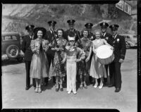 Los Angeles Police Department annual parade color guard members and young drum major pose with officers, July 9, 1937