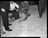 Wrestler Man Mountain Dean laying down in the ring at the Olympic Arena, Los Angeles, 1937
