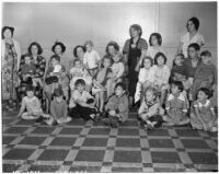 Women and children gather in support of the United Mill, Mine, and Smelter Workers Union who were on strike during the building of the Colorado River Aqueduct, Los Angeles, 1937