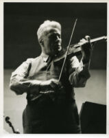 Fritz Kreisler playing the violin, 1947 [descriptive]