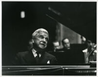 Artur Schnabel playing piano in performance, 1947 [descriptive]