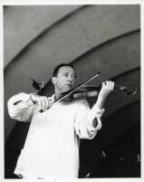 Jascha Heifetz playing the violin, 1957 [descriptive]