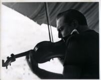 Isaac Stern playing the violin, 1958 [descriptive]