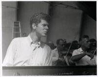 Van Cliburn with orchestra in background, 1958 [descriptive]