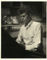 Van Cliburn playing the piano, 1958 [descriptive]