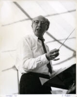 Aaron Copland conducting at the podium, Los Angeles, 1960 [descriptive]