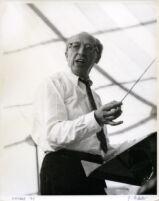 Aaron Copland conducting at the podium, Los Angeles, 1960 [descriptive]