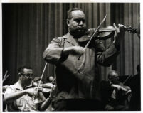 David Oistrakh playing the violin in rehearsal, Los Angeles, 1964 [descriptive]