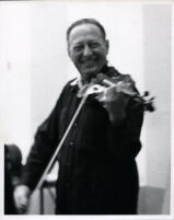 Jascha Heifetz playing the violin, 1966 [descriptive]