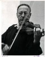 Jascha Heifetz playing the violin, 1966 [descriptive]