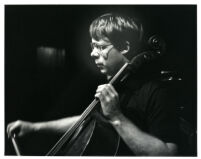 Lynn Harrell playing the cello, 1980 [descriptive]