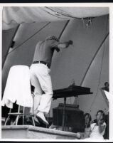 Leonard Bernstein conducting at the podium, Los Angeles, 1985 [descriptive]