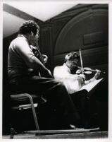 Itzhak Perlman playing the violin with Pinchas Zukerman playing the viola, 1985 [descriptive]