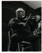 Isaac Stern playing the violin, 1985 [descriptive]