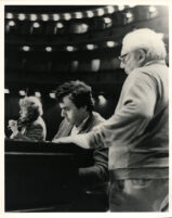 Yefim Bronfman playing the piano next to Isaac Stern, 1985 [descriptive]