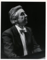 Walter Klien playing the piano in concert attire, 1986 [descriptive]