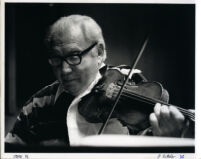 Isaac Stern playing the violin, 1986 [descriptive]