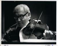 Isaac Stern playing the violin, 1986 [descriptive]