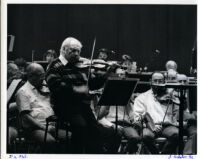 Isaac Stern playing the violin with the LA Philharmonic in rehearsal, Los Angeles, 1986 [descriptive]