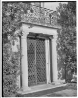 W. R. Dunsmore residence, exterior, view of doorway with metal grille gate, Los Angeles, 1930