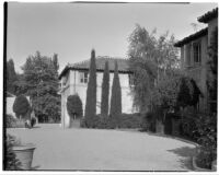 W. R. Dunsmore residence, exterior view towards forecourt and house from end of driveway, Los Angeles, 1930
