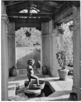 W. R. Dunsmore residence, view towards fountain with putto in pergola, Los Angeles, 1930
