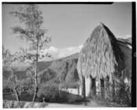 Bettye K. Cree studio, exterior view with a palapa shading a doorway, Palm Springs, 1929