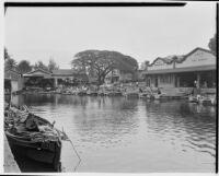 Wharf with fishing boats and fish market, Hawaii, 1928