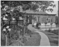 A. G. Mersy residence, back yard with rose standards and lawn, Pasadena, 1933
