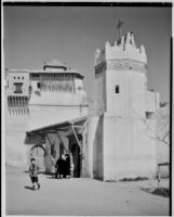 Several people gathered outside a church, Algiers, 1929