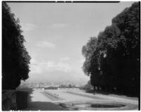 Parc de Saint-Cloud, view of a fountain and two rows of small plants, Saint-Cloud, France, 1929