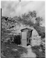 Doorway in a stone wall in the countryside, Italy, 1929