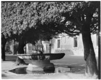 Shallow fountain in a shady courtyard in Rome, Italy, 1929