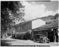 Outdoor café and automobile in front of a shop, Balaruc-le-Vieux, France, 1929