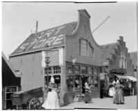 Shoppers in the street outside an art store in Holland, 1929