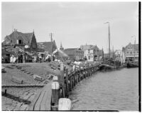 Stores and sailboats on the waterfront, Holland, 1929