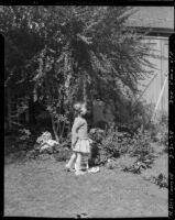 Three-year-old Rosita Dee Cornell standing in a yard, California, 1934