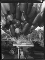 Street vendor with balloons at the Rose Parade, Pasadena, 1927