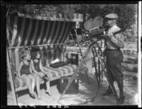 Two Estes children on glider swing posing for cameraman, [Van Nuys?], between 1928 and 1936