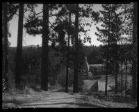 View towards the village with a rustic half-timbered building with turret, Lake Arrowhead, 1929