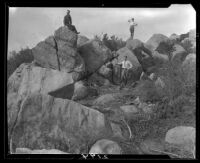 Rock formations and men near Saddle Peak, Los Angeles, [1920s]