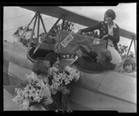 Young women and pilot with airplane and Easter lilies, Los Angeles, 1931
