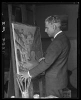 Wilson Silsby in studio, with easel, brush, and painting, Los Angeles, 1927