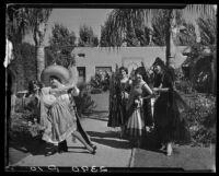 Women in Spanish-style dress, 2 dancing, Harry Gorham residence, Santa Monica, 1928